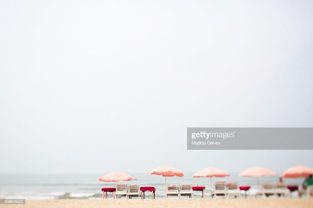 Sun loungers with umbrellas on a Goa beach. India : Stock Photo