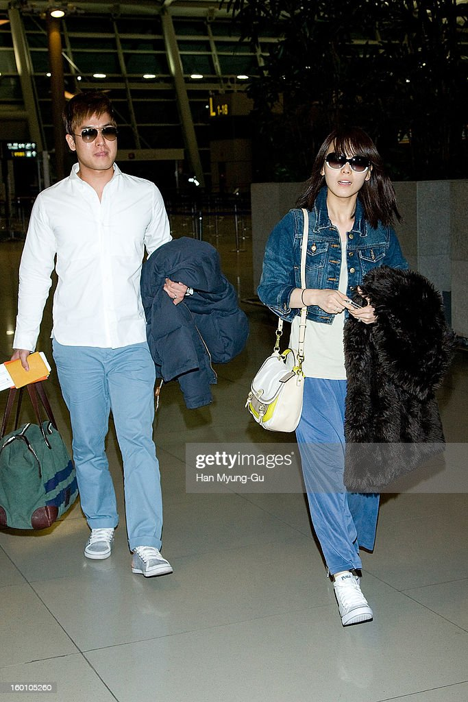 Sun Min of South Korean girl group Wonder Girls and her groom James Park are seen on departure at Incheon International Airport on January 26, 2013 in Incheon, South Korea.