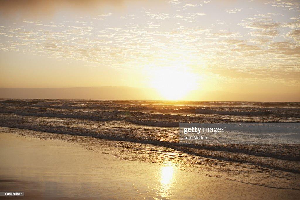 Sun on horizon over ocean : Stock Photo