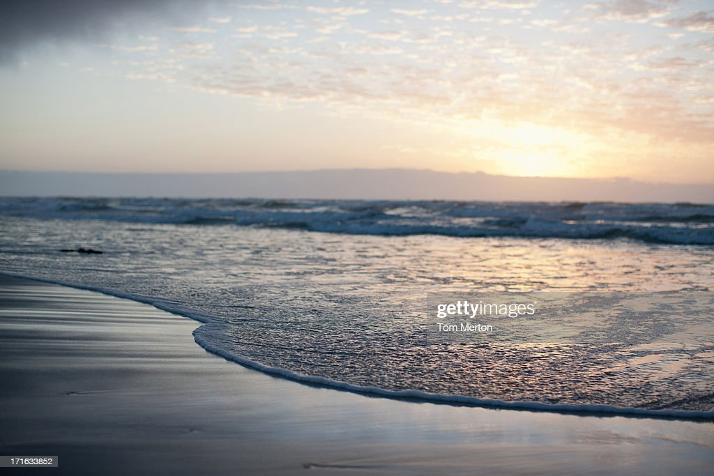 Sun on horizon over ocean : Stock Photo