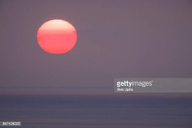 Sun over ocean in Kona, Hawaii