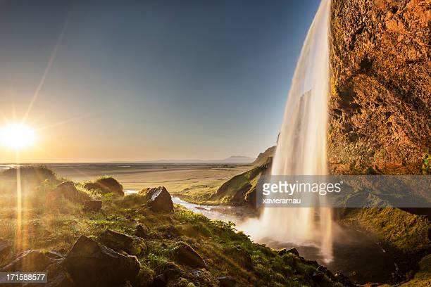 Sun over Seljalandsfoss waterfall