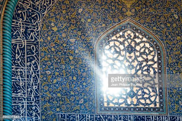 Sun rays across the window of Sheikh Lotfollah Mosque, Isfahan, Iran