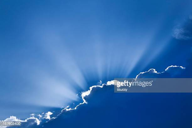 Sun rays peeking out from behind clouds, exemplifying hope