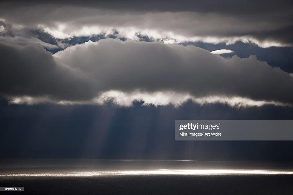 Sun rays stream down thru clouds, Kamai National Park, Alaska, USA : Stock Photo