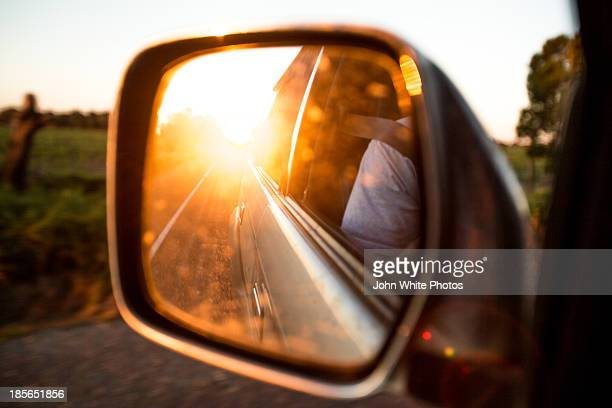Sun reflected in a car mirror