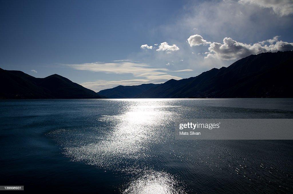 Sun reflections on alpine lake