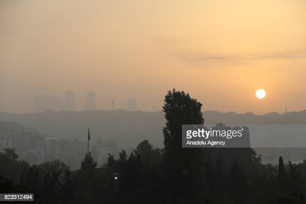 Sun rises asthe heavy mist blankets Istanbul Turkey on July 27 2017