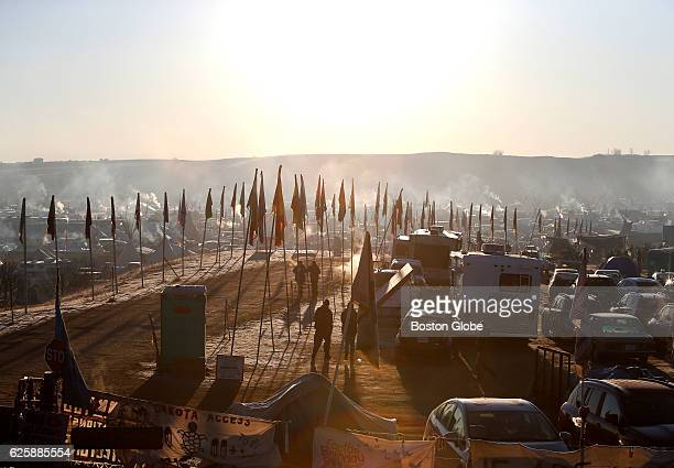 Sun rises over Oceti Sakowin camp in Cannon Ball ND near Standing Rock on Nov 25 during an ongoing dispute over the building of the Dakota Access...
