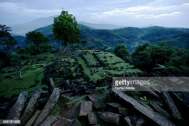 Sun rises over the Gunung Padang megalithic site in West Java Indonesia July 6 2013 The site dates to at least 5000 BC and is believed to have been...