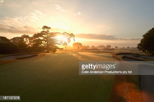 Sun rising over golf course