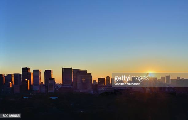 Sun rising over skyline of Tokyo's Downtown