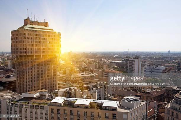 Sun rising over urban skyline
