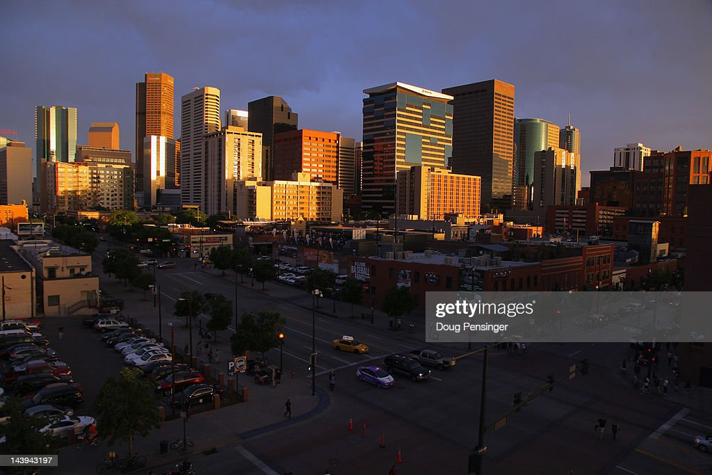 Sun sets on downtown Denver as see from Coors Field in LoDo as the Atlanta Braves defeated the Colorado Rockies 139 at Coors Field on May 5 2012 in...