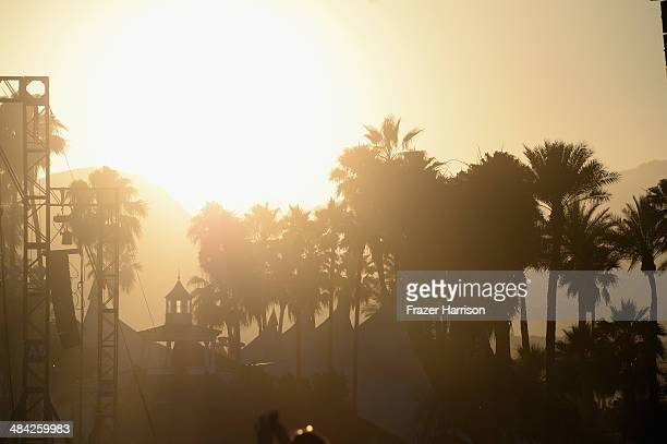 Sun sets over palm trees during day 1 of the 2014 Coachella Valley Music Arts Festival at the Empire Polo Club on April 11 2014 in Indio California