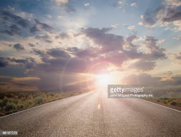 Sun setting on remote highway