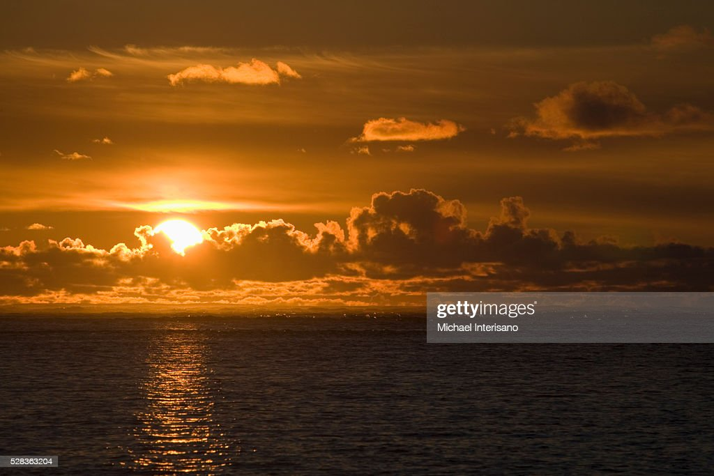 Sun Setting On The Ocean With The Sunlight Reflecting On The Water; Lincoln City Oregon United States Of America