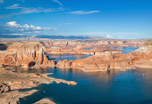 The stunning beautiful Lake Powell with the warm evening sun hitting the red rocks. Houseboats below.