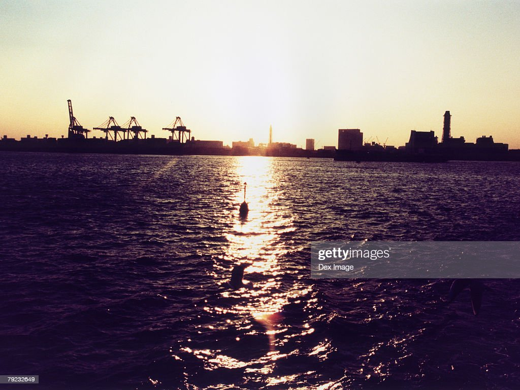 Sun setting over ocean, Tokyo Bay, Japan : Stock Photo