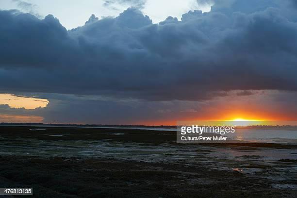 Sun setting over rural lake
