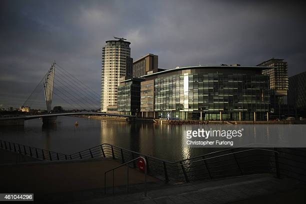 Sun shines on the buildings at Salford Quays which is home to the BBC ITV television studios and also houses many media production companies on...