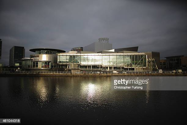 Sun shines on the buildings at The Lowry Centre and Media City in Salford Quays which is home to the BBC ITV television studios and also houses many...