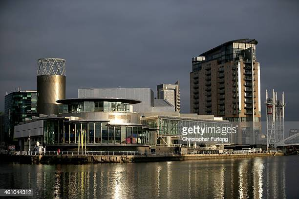 Sun shines on the water at The Lowry Centre and Media City in Salford Quays which is home to the BBC ITV television studios and also houses many...