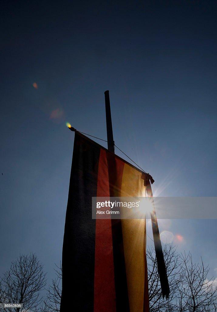 Sun shines through a German lag on halfmast at a sports field near Albertville high school on March 21 2009 in Winnenden near Stuttgart Germany 17...
