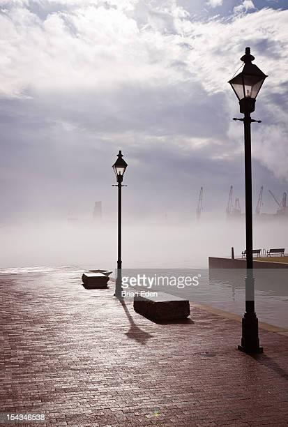 Sun shines through fog on Baltimore Harbor