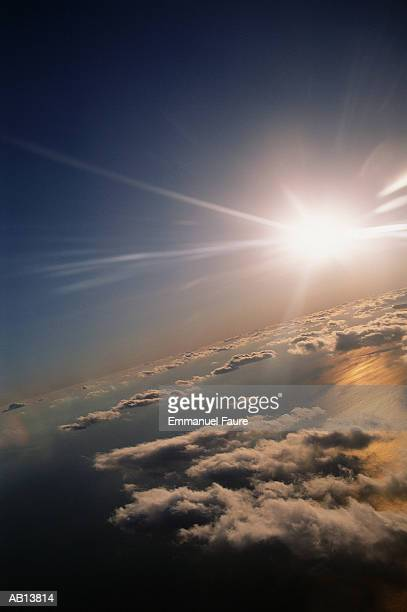 Sun shining above clouds, aerial view