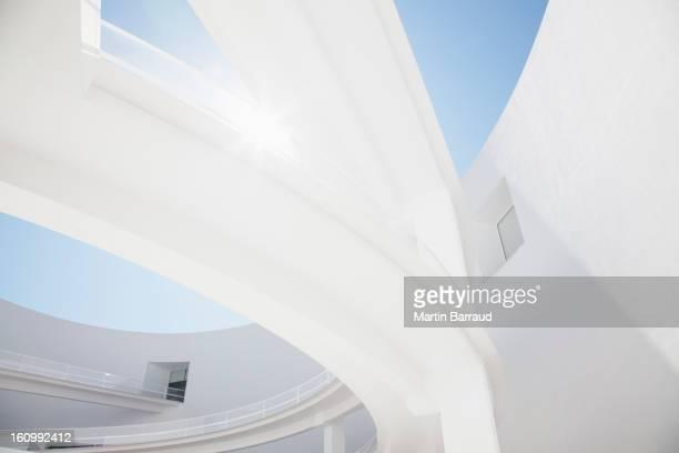 Sun shining behind elevated walkway
