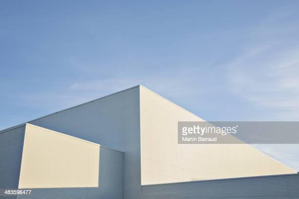 Sun shining on buildings against blue sky