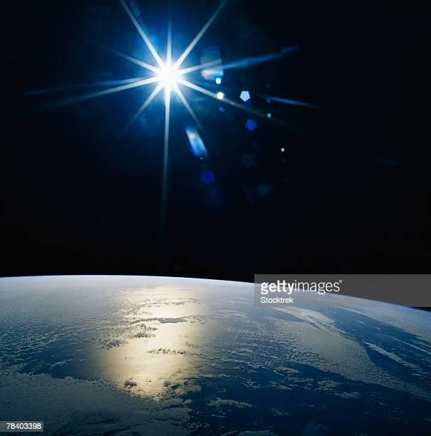 Sun shining over Earth