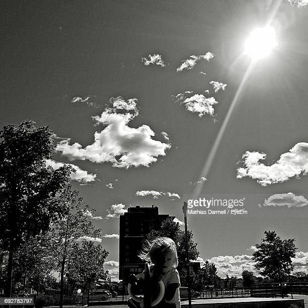 Sun Shining Over Girl Playing In City