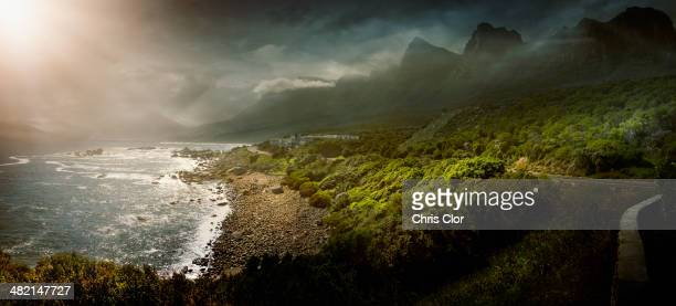 Sun shining over rural coastline, Cape Town, Western Cape, South Africa