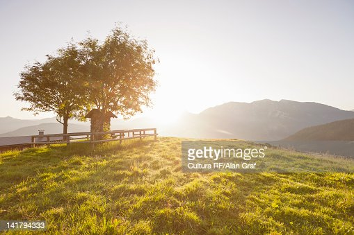 Sun shining over rural hills : Photo