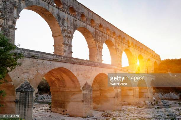 Sun shining through aqueduct