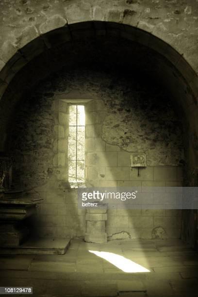 Sun Shining Through Old Stone Church Window