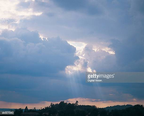 Sun shining through storm clouds