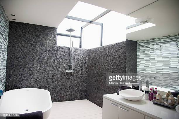 Sun shining through window in modern bathroom