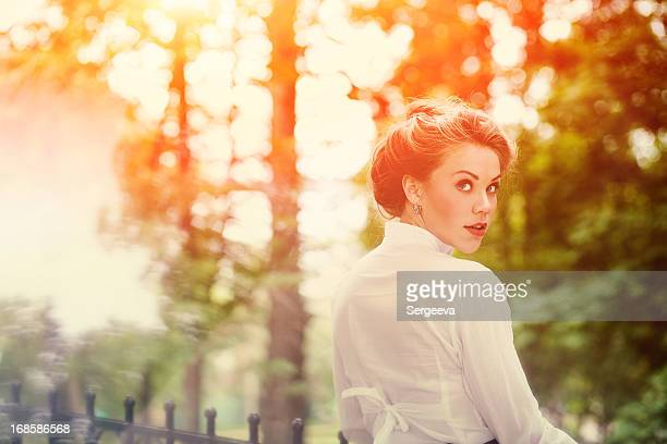 Sun tinted photo of a pretty woman dressed in 1940's style