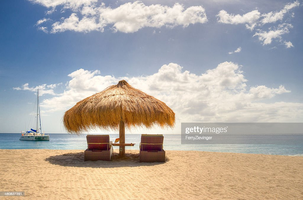 Saint Lucia, Anse Chastanet beach, View of umbrella and sun loungers