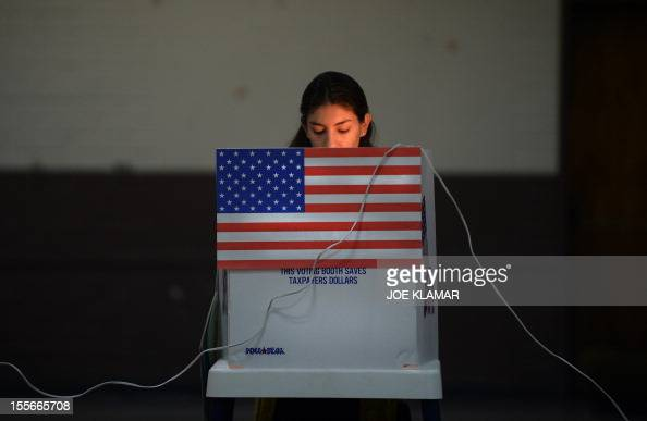 A Sun Valley resident votes at the polling station located at Our Lady of The Holy Church on election day at the Sun Valley's Latino district Los...