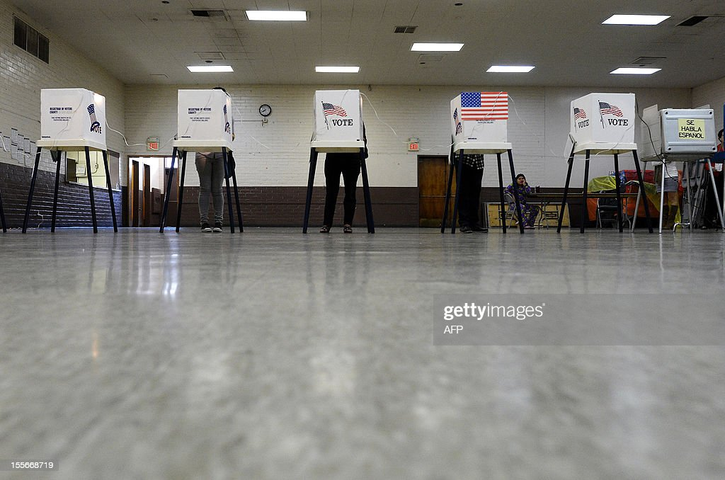 Sun Valley residents vote at Our Lady of The Holy Church on election day at the predominantly Latino Sun Valley district of Los Angeles on November 6...