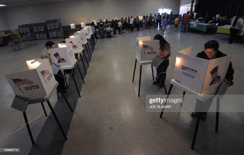 Sun Valley residents vote at the polling station located at Our Lady of The Holy Church on election day at the Sun Valley's Latino district, Los Angeles County, on November 6, 2012 in California. AFP PHOTO /JOE KLAMAR