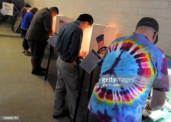 Sun Valley residents vote at the polling station located at Our Lady of The Holy Church on election day at the Sun Valley's Latino district Los...