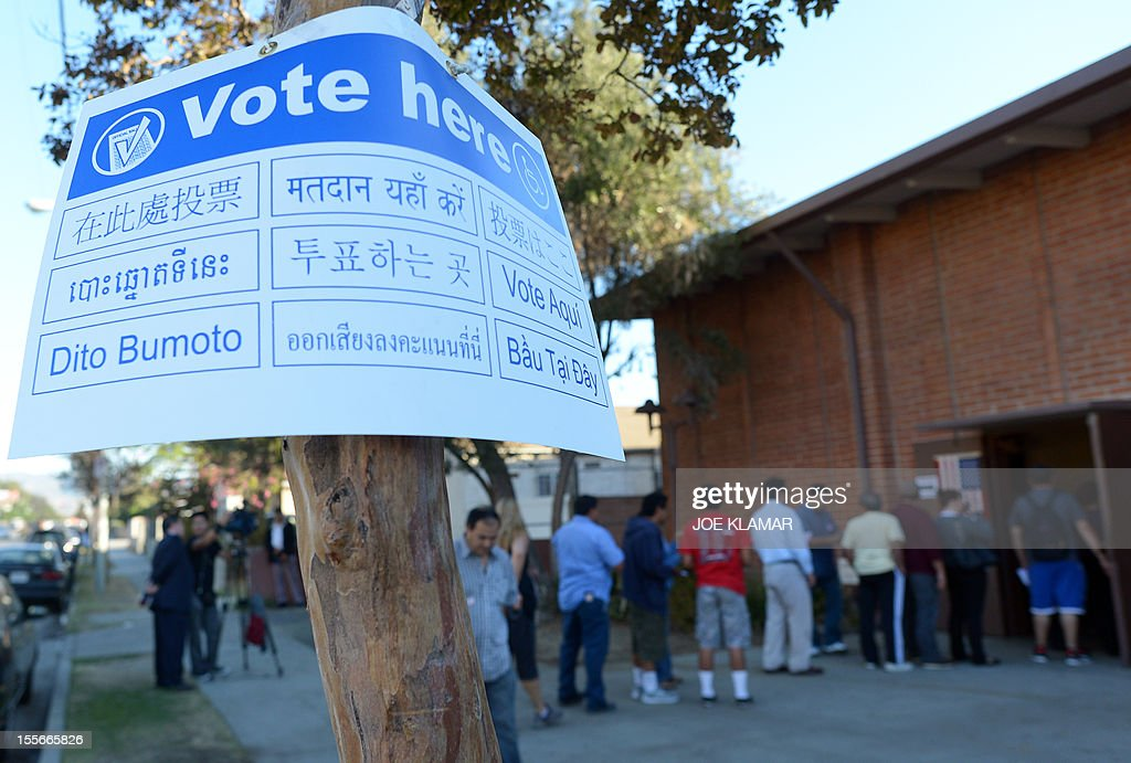 Sun Valley residents wait in line to vote at the polling station located at Our Lady of The Holy Church on election day at the Sun Valley's Latino district, Los Angeles County, on November 6, 2012 in California.
