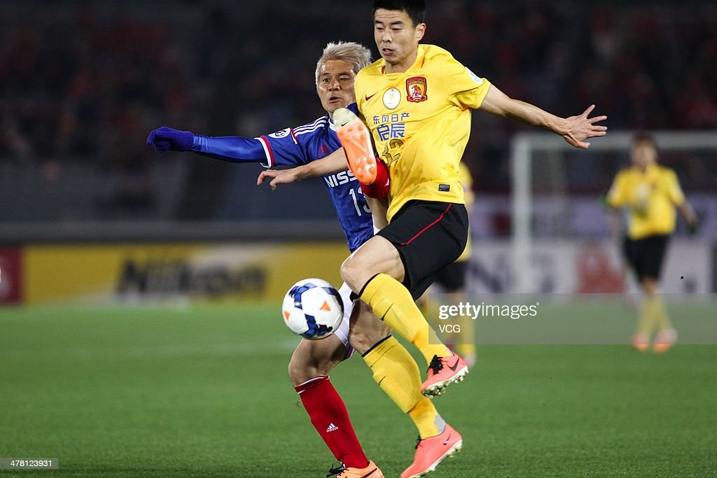 <a gi-track='captionPersonalityLinkClicked' href=/galleries/search?phrase=Sun+Xiang&family=editorial&specificpeople=2167195 ng-click='$event.stopPropagation()'>Sun Xiang</a> #32 of Guangzhou Evergrande and <a gi-track='captionPersonalityLinkClicked' href=/galleries/search?phrase=Yuzo+Kobayashi&family=editorial&specificpeople=2342516 ng-click='$event.stopPropagation()'>Yuzo Kobayashi</a> #13 of Yokohama F. Marinos battle for the ball during the AFC Asian Champions League match between Yokohama F. Marinos and Guangzhou Evergrande at the Nissan Stadium on March 12, 2014 in Yokohama, Japan.