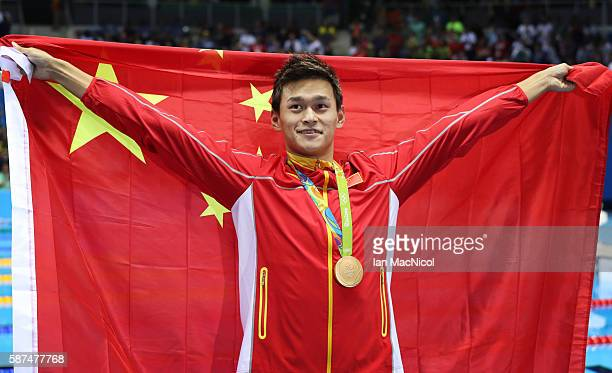Sun Yang of China celebrates after he wins the Men's 200m Freestyle on Day 3 of the Rio 2016 Olympic Games at the Olympic Aquatics Stadium on August...