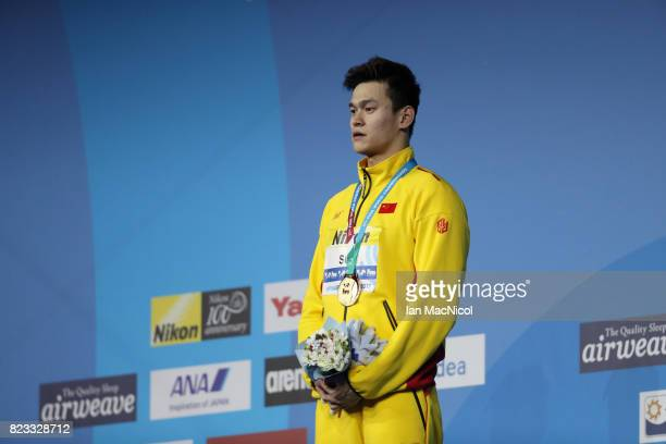 Sun Yang of China poses with his gold medal for winning the Men's 400m Freestyle during day ten of the FINA World Championships at the Duna Arena on...